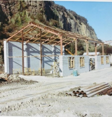 The construction of the first workshop building at Stone Street yard. The steel framework came from the Waipori gorge power project.