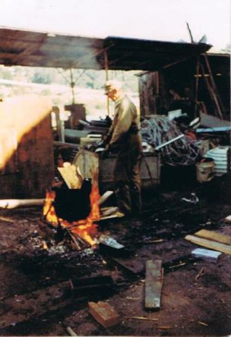 Here is Bill  with a good fire heating up a pot of lead, then pouring it into moulds, 1983